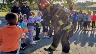 Moulton-Branch Elementary students learn fire safety after firefighters visit school