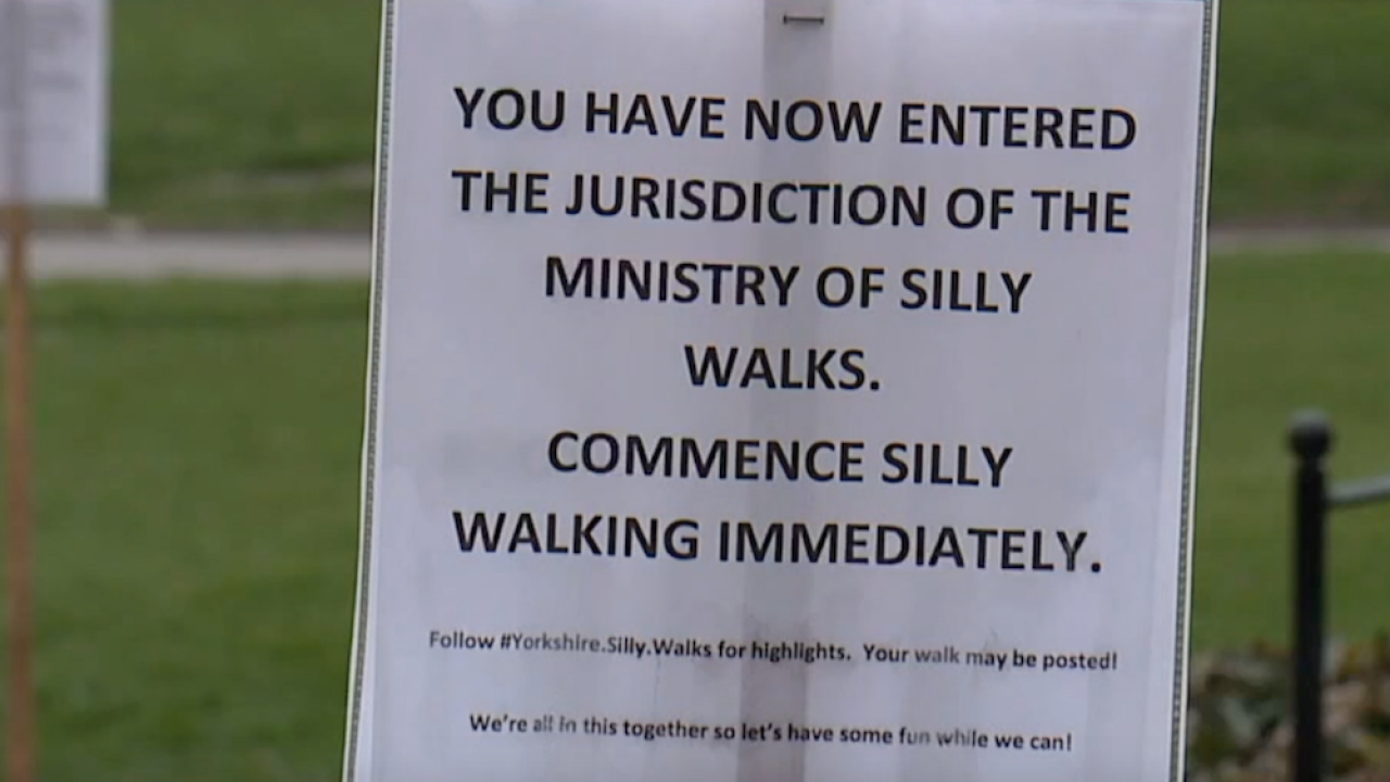 Michigan family makes walks sillier with Monty Python-inspired signs