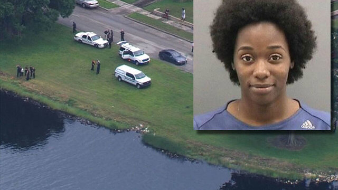 Mother charged after tossing child into river
