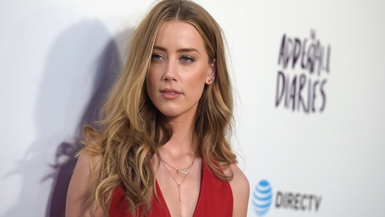 Amber Heard's ex-girlfriend speaks out