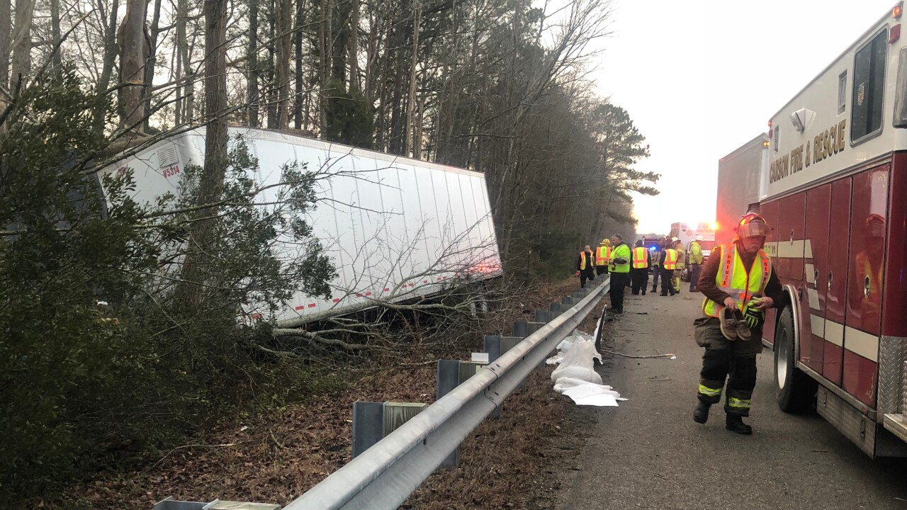 Truck driver swerves off I-95 into woods; blames bad driver for crash