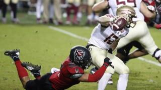 North Carolina State Wolfpack linebacker C.J. Hart Jr. sacks Florida State Seminoles QB Chubba Purdy in 2020