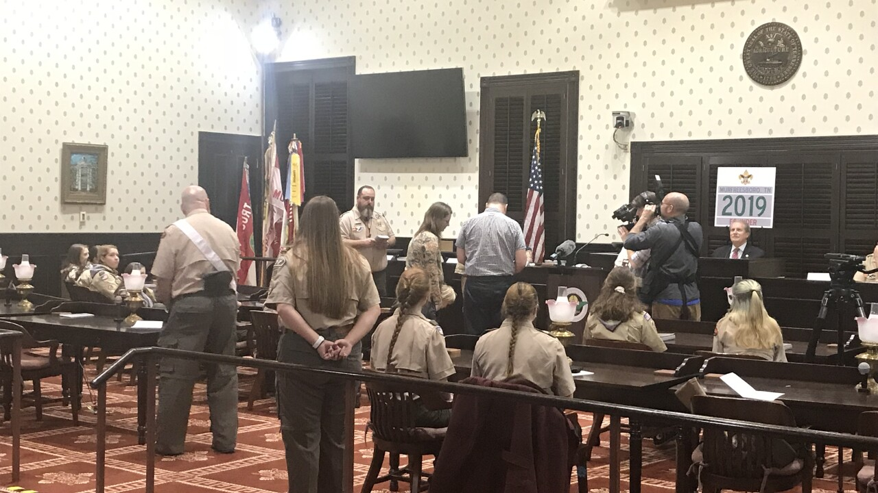 Girls sworn into boy scouts