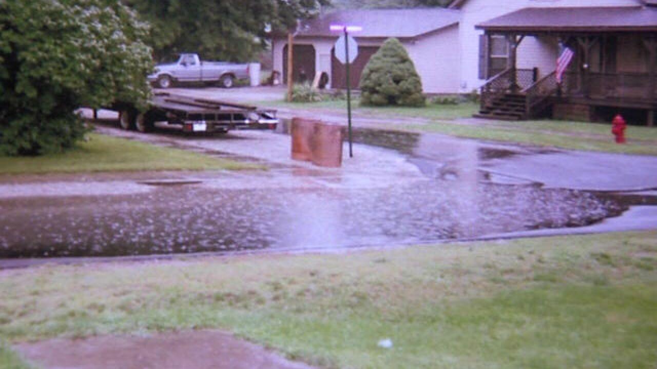 Neighbor blames poor paving for street flooding