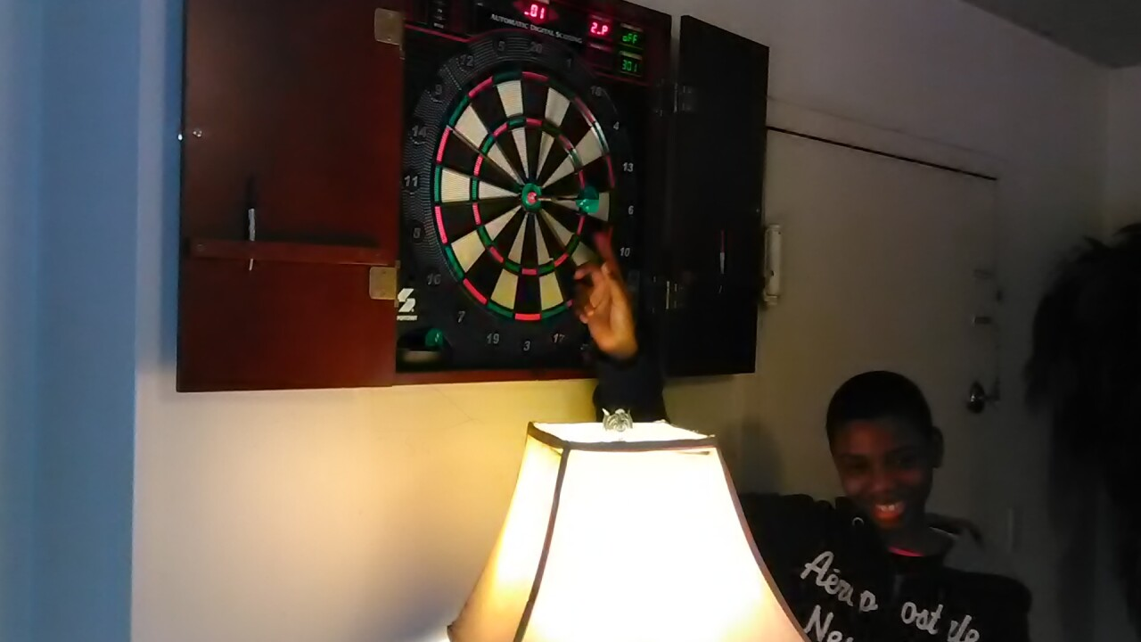 Eubanks_son_with_dart_board.jpeg