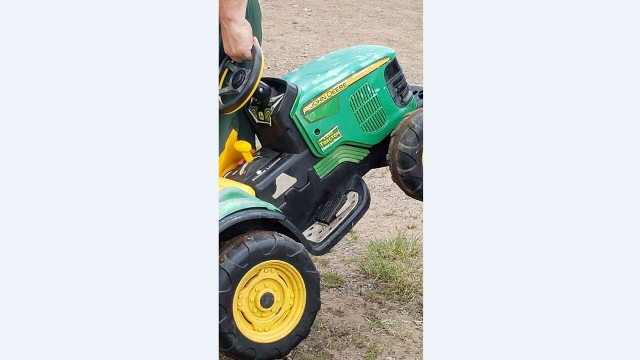 A missing toddler drove himself down to the county fair on his toy tractor