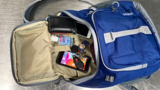 Knapsack with items from pockets inside.jpg