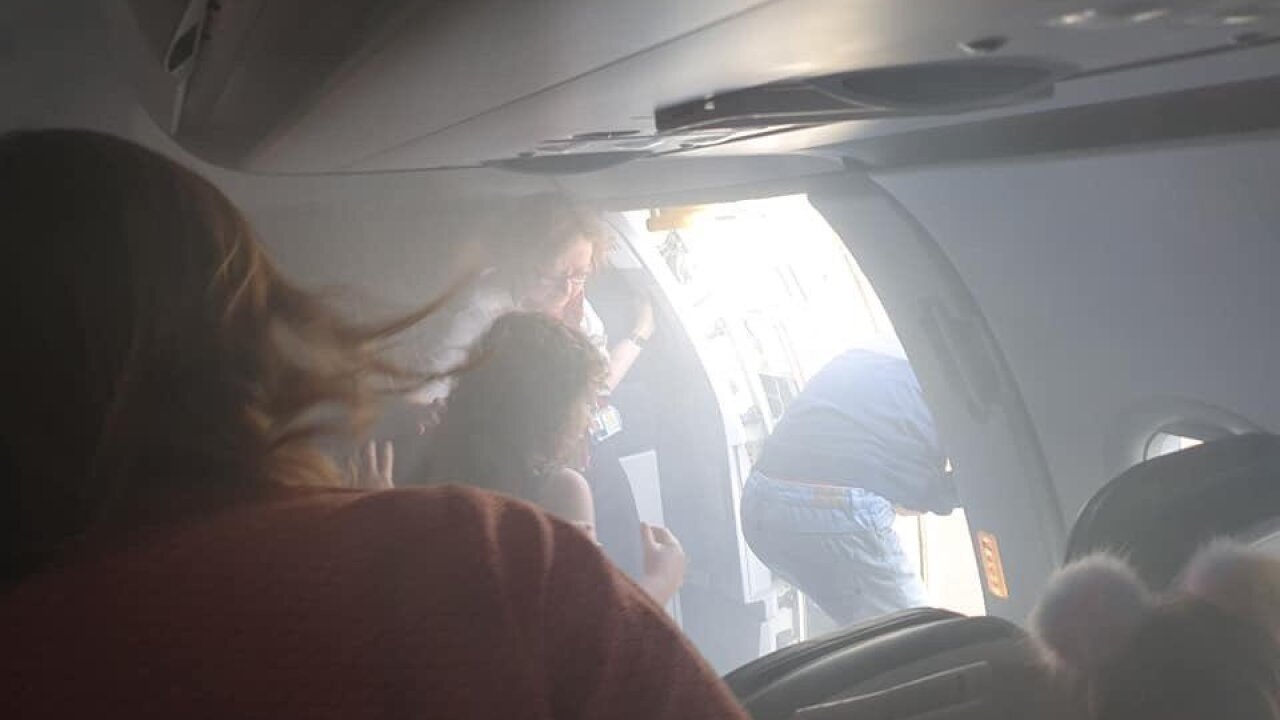 A British Airways cabin filled with smoke during a flight. Passengers described it as a 'horror film'
