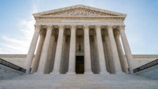 Justices allow enforcement of new green cardrule