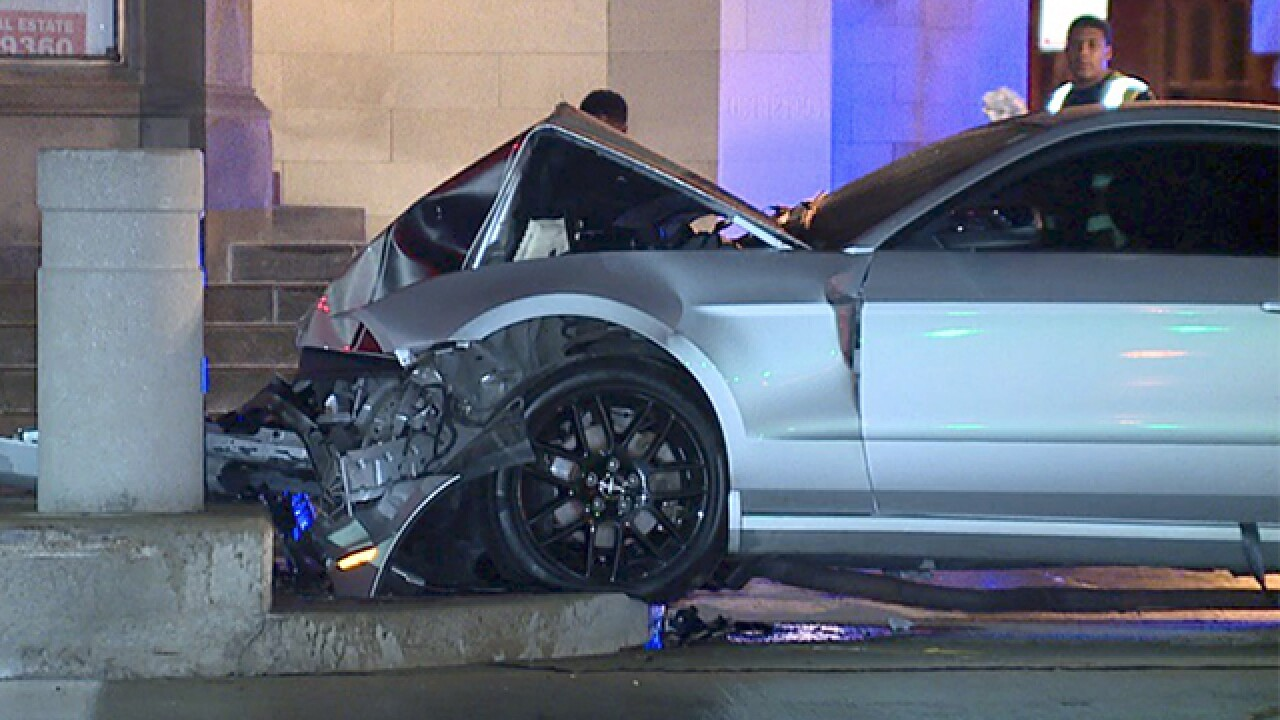 Mustang crashes into RTA bus stop on Euclid