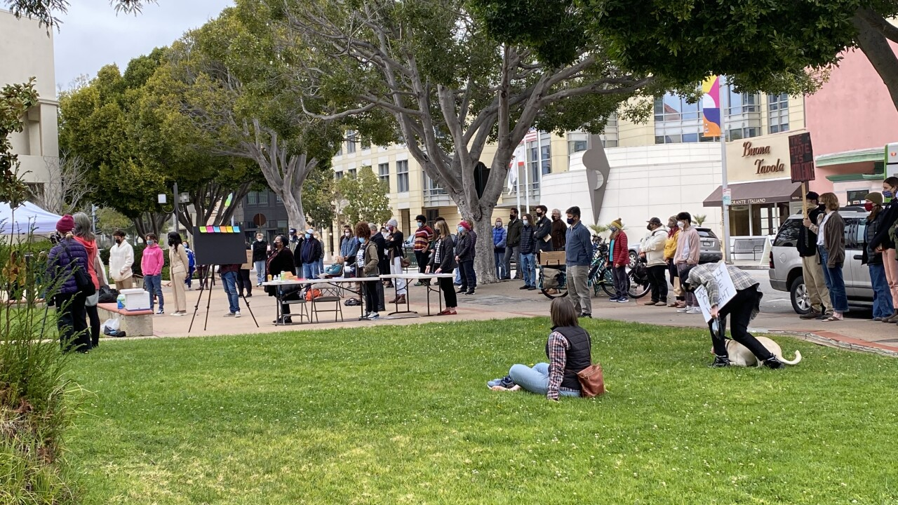 People gathered at the SLO County Courthouse