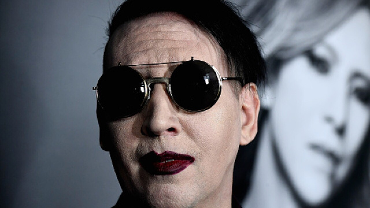 Marilyn Manson points fake gun at crowd during San Bernardino concert