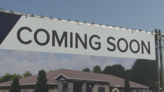 Coming Soon sign at the new location