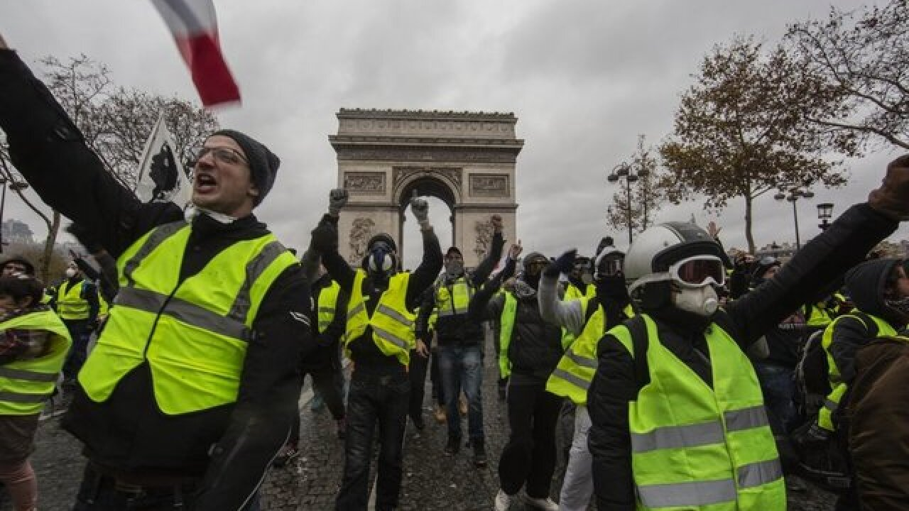 Paris protests: France to suspend fuel price hike amid 'yellow vest' campaign