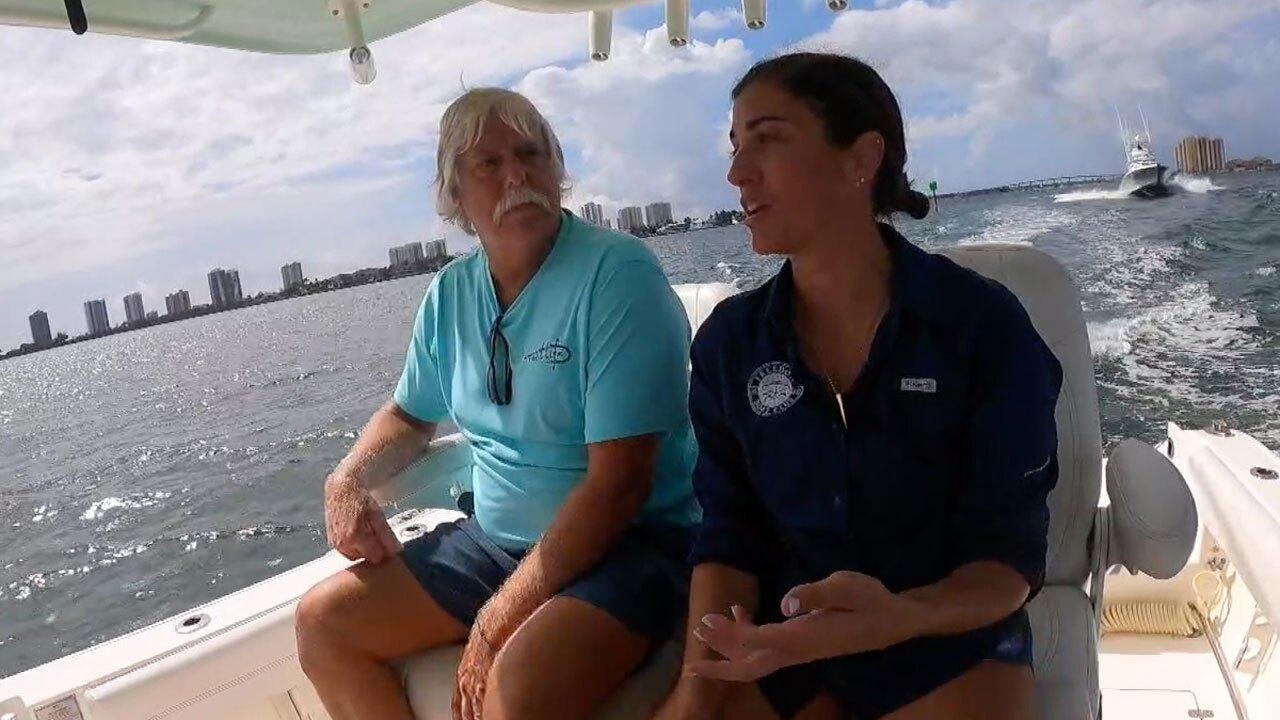 Boater Tom Holland and Capt. Lauren DeLuca