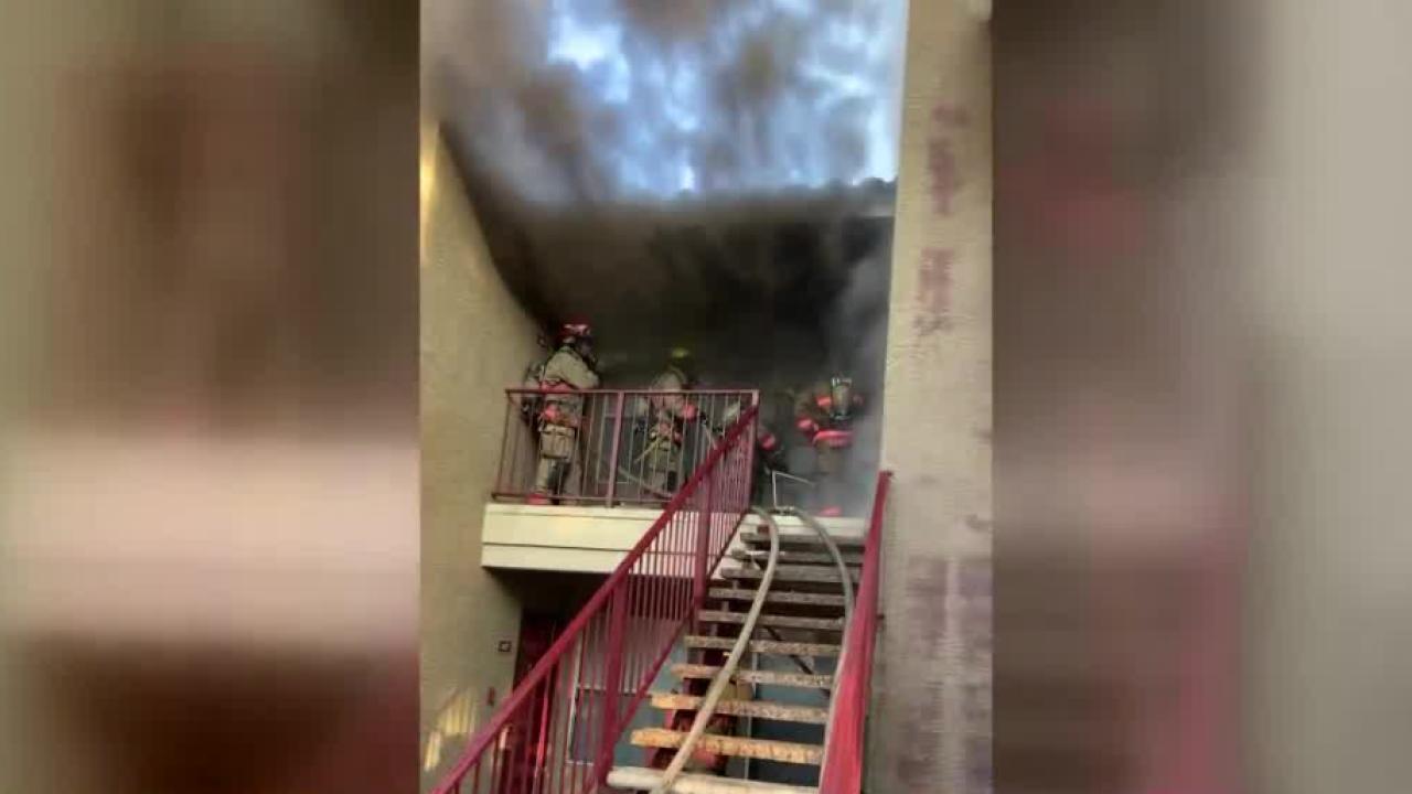 firefighters batttleing blaze.PNG
