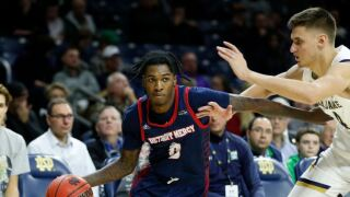 SOUTH BEND, IN - DECEMBER 10: Detroit Mercy Titans guard Antoine Davis (0) drives past Notre Dame Fighting Irish forward Nate Laszewski (14) during the mens college basketball game between Detroit Mercy Titans and the Notre Dame Fighting Irish on December 10, 2019 at Purcell Pavilion in South Bend, IN.