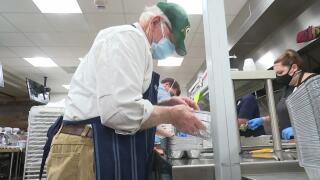 Volunteers pack Thanksgiving meals at Lambeau