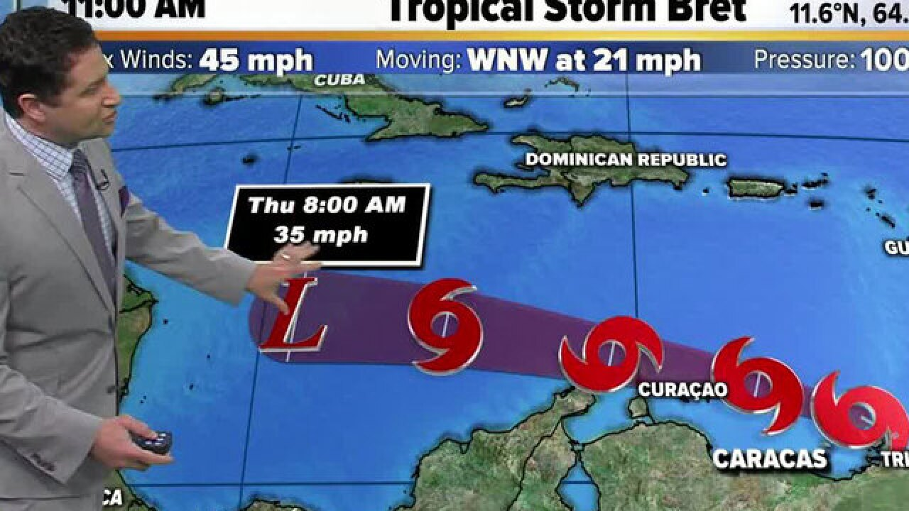Bret degenerates into tropical wave