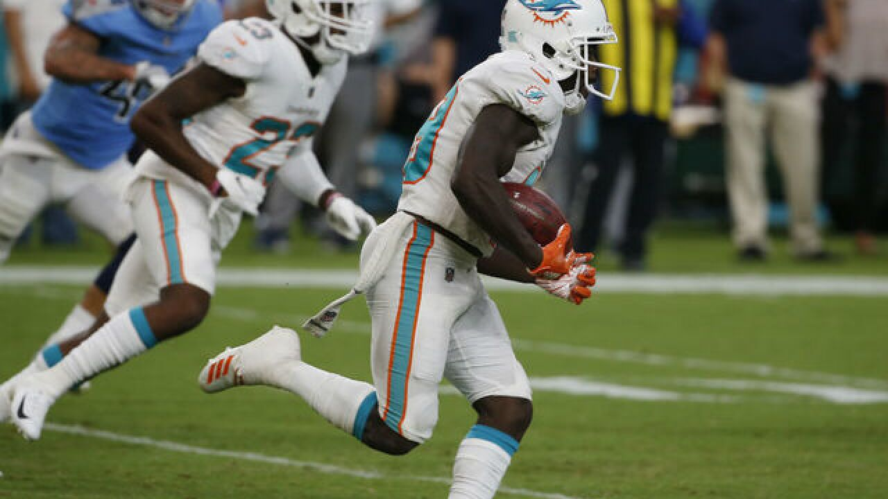 Dolphins overcome 2 lightning delays to beat Titans 27-20