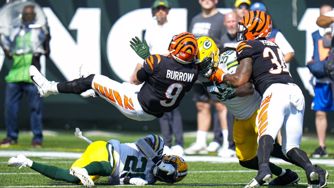 Joe Burrow hit by two Packers