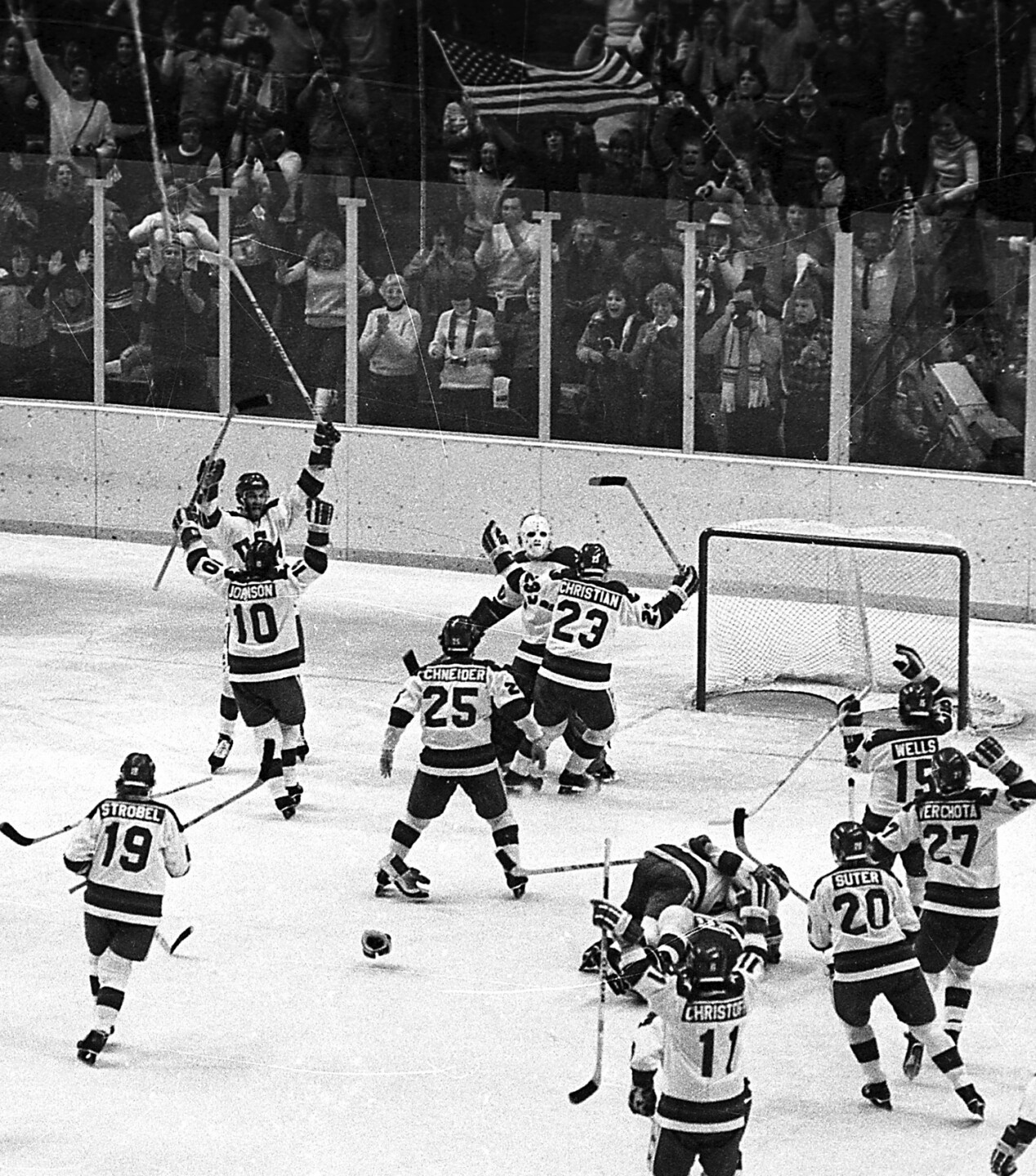 In this Feb. 22, 1980, file photo, the U.S. men's ice hockey team rushes toward goalie Jim Craig after their 4-3 upset win over the Soviet Union in the semifinals of the Winter Olympic Games in Lake Placid, N.Y. (AP Photo/File)