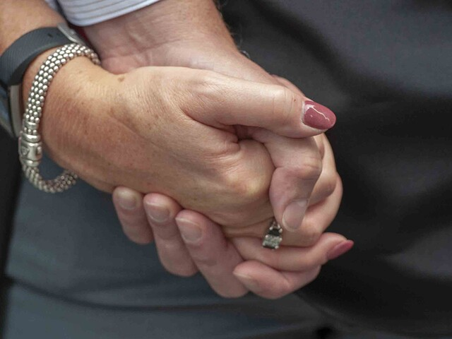 Hugs, tears and tightly held hands at Fountain Square vigil
