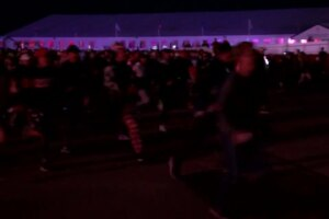 Amped up fans make a run for first tee at the Ryder Cup