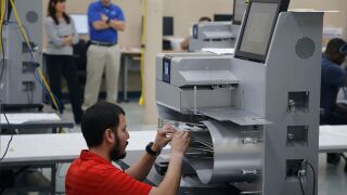 Florida county collects uncounted ballots left in a mail facility