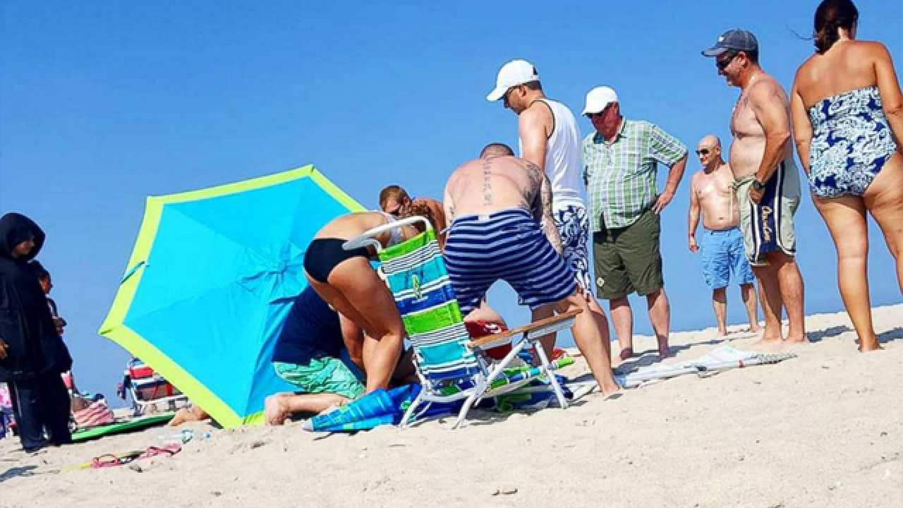 Woman impaled by umbrella at beach