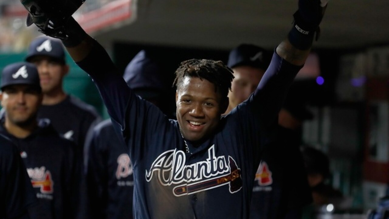 Acuna singles, scores in MLB debut, Braves beat Reds 5-4