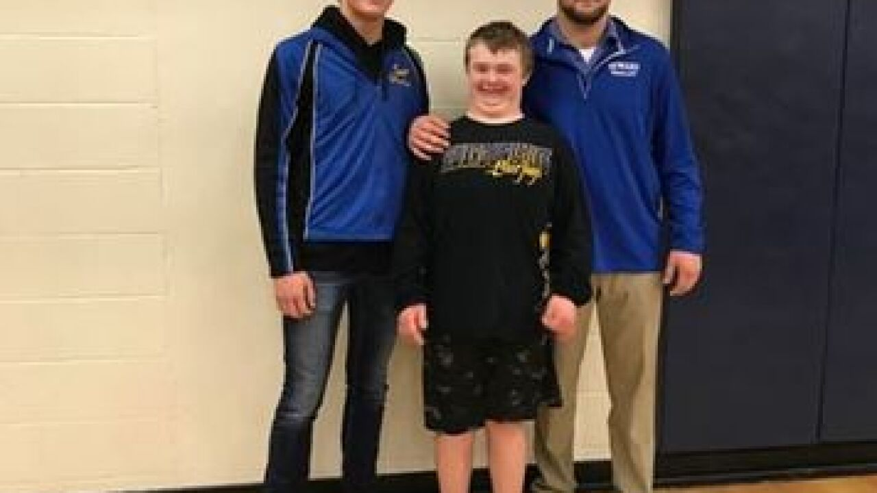 Wrestler with Down syndrome shines at tournament