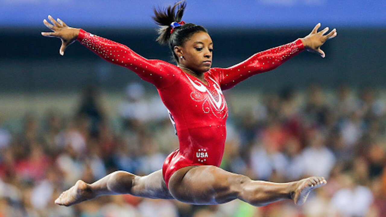 Announcer regrets tweets about Simone Biles' parents