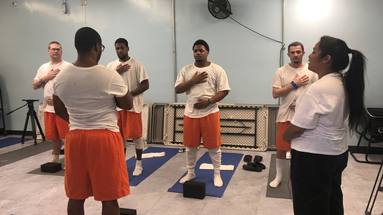 Norfolk Jail graduates first class of inmates from yoga course