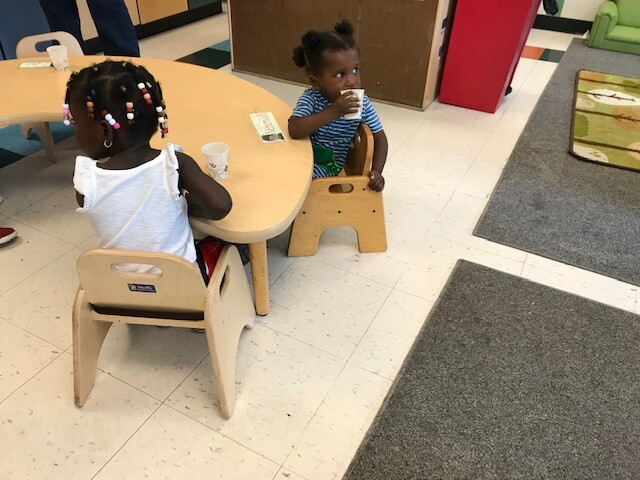 Two female students sitting at a table at a Milwaukee daycare