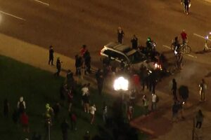 Full video: Man detained after running protester over with his car, police say