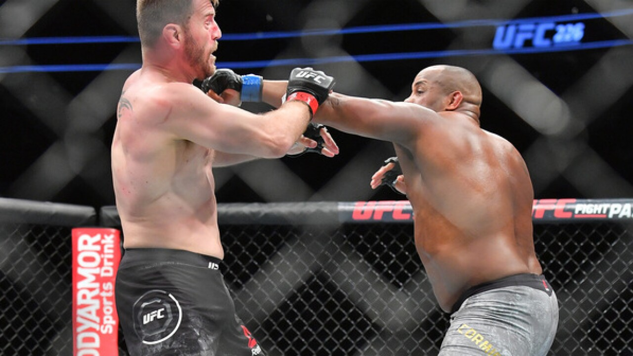 Cormier stops heavyweight Miocic to win 2nd UFC title belt
