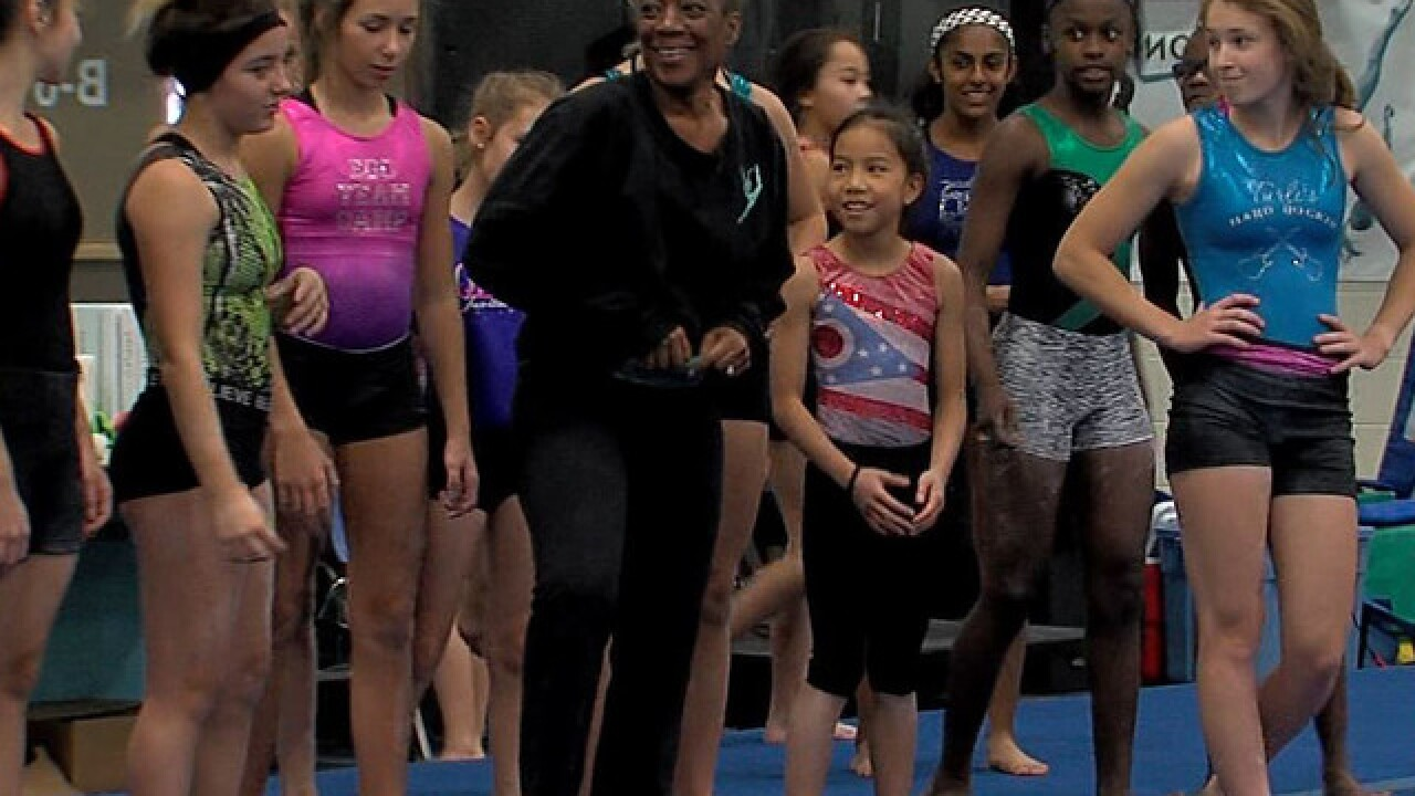 Local gymnastics coach adds author to her resume