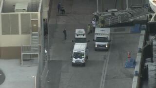 Sick passenger of Holland America Zaandam placed in ambulance at Port Everglades