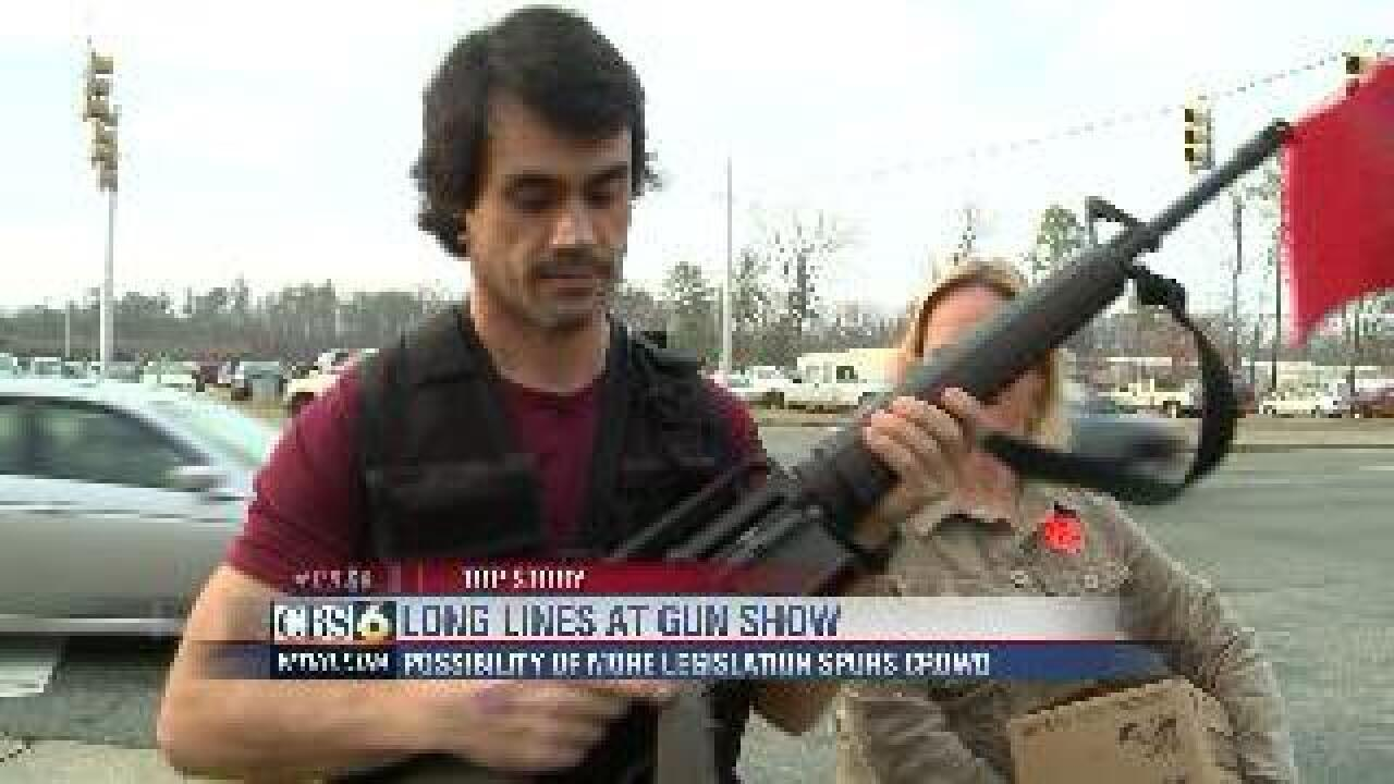 Gun show crowd lines up for guns, ammo
