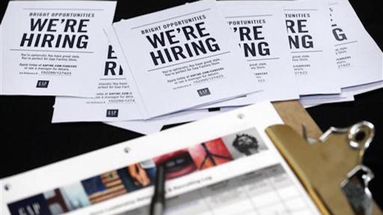 US claims for jobless aid fall, sign of employer resilience