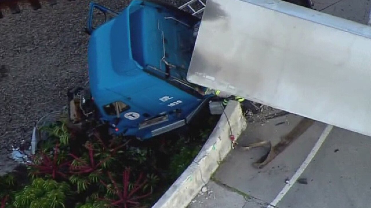 Semi dangles from ramp in Florida
