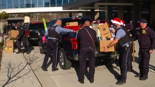 Santa Clause delivers toys at KU