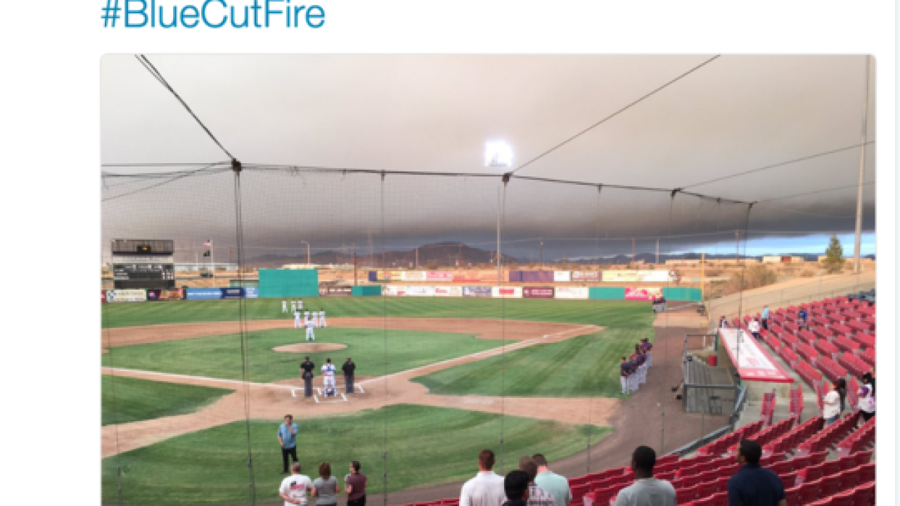 Baseball game plays in shadow of wildfire