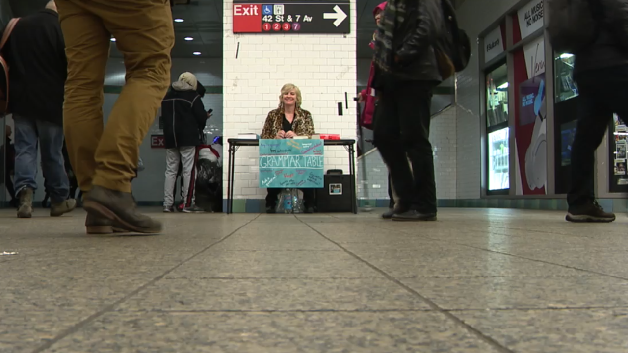 In one of New York's busiest subway stations, you'll find this 'grammar guru'