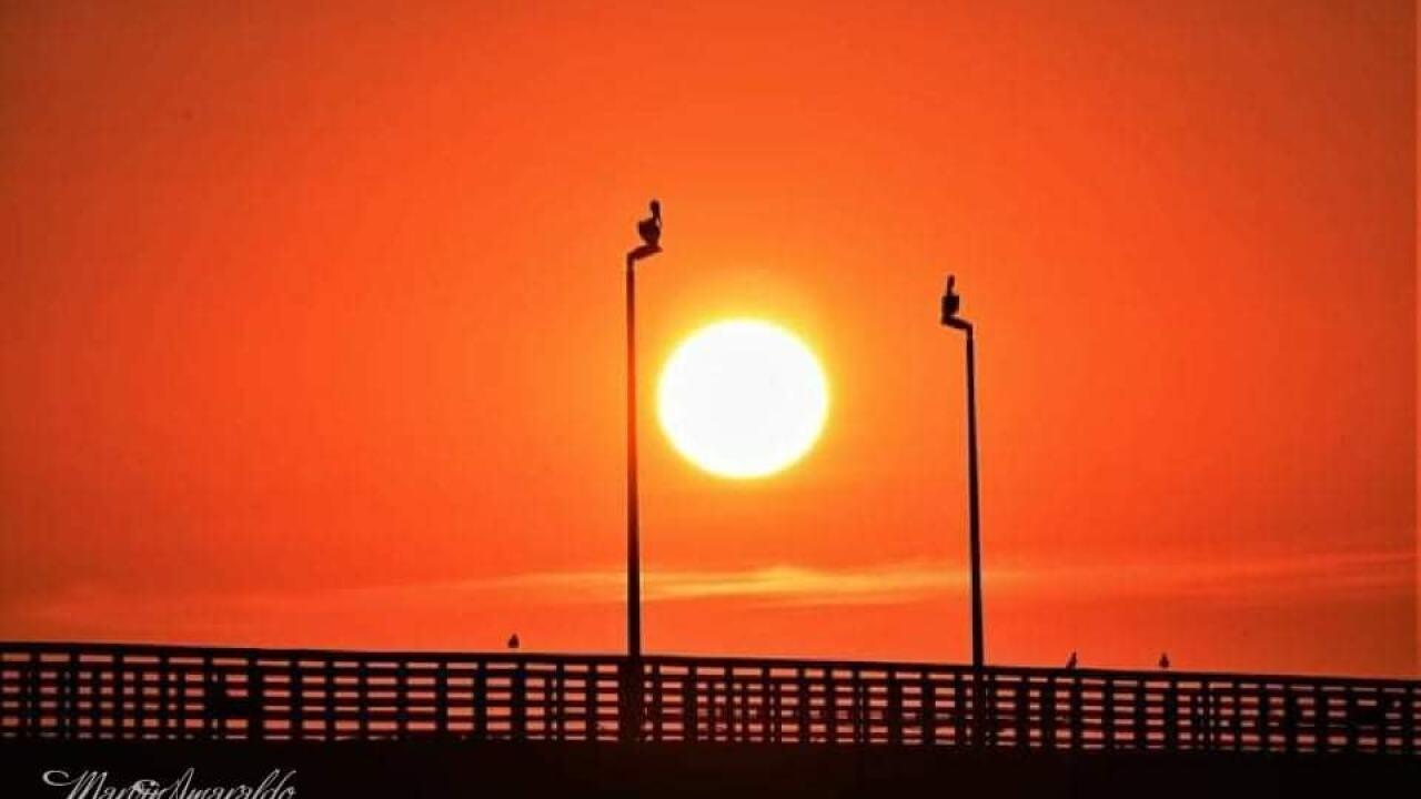 Sun shining over Bob Hall Pier - Photo By: FB Coastal Bend Weather Watcher Marvin Amaraldo