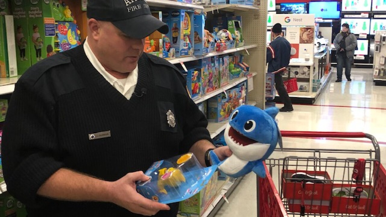 Akron firefighters adopt family