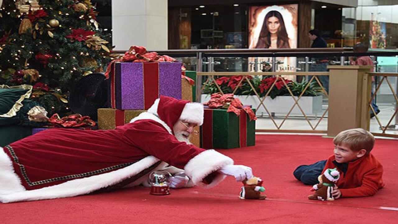 Why is Santa lying on floor in Christmas photo?