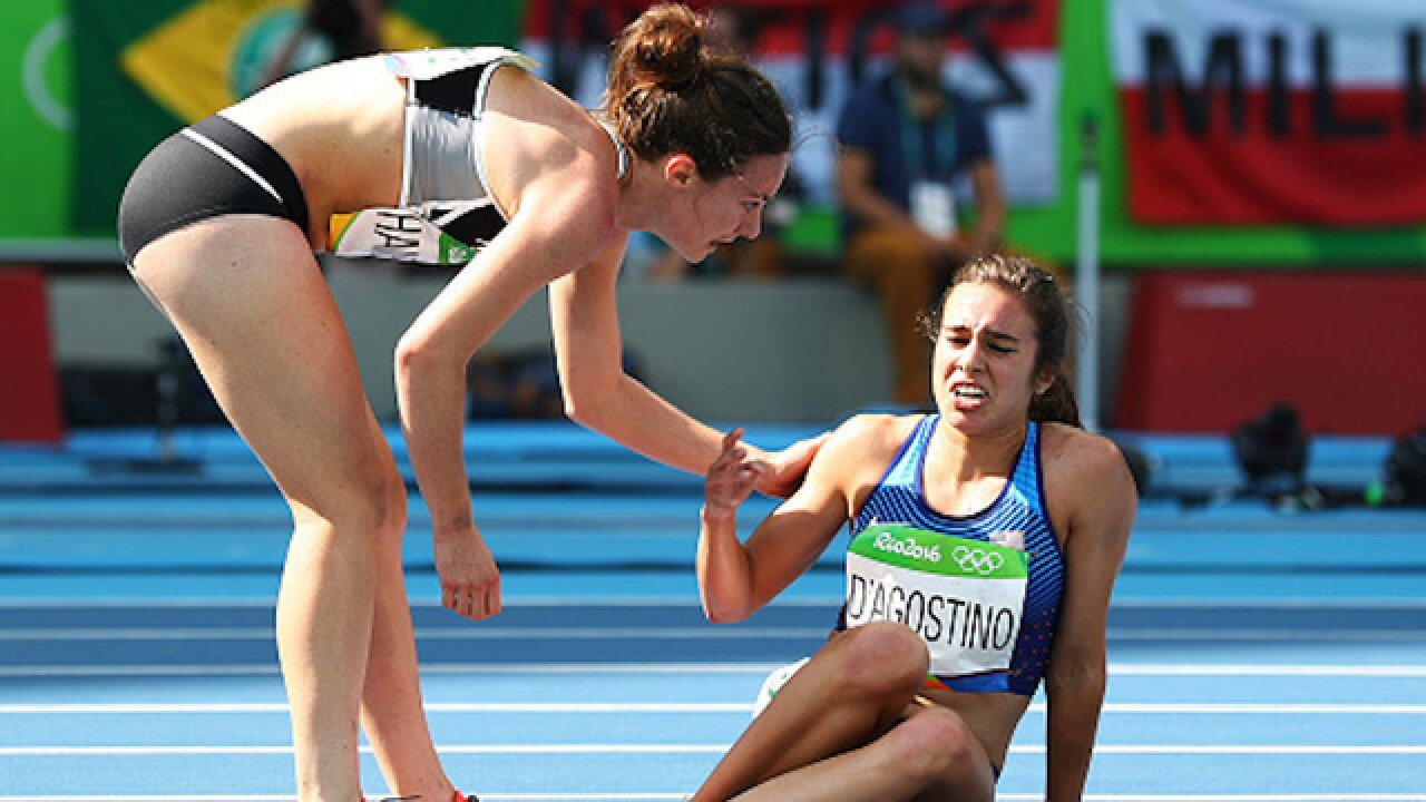 Olympic spirit shines as runner helps competitor up