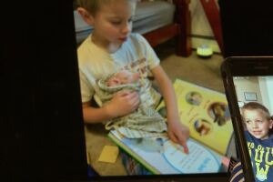 Helena 7 year-old practices reading at home - to his animals